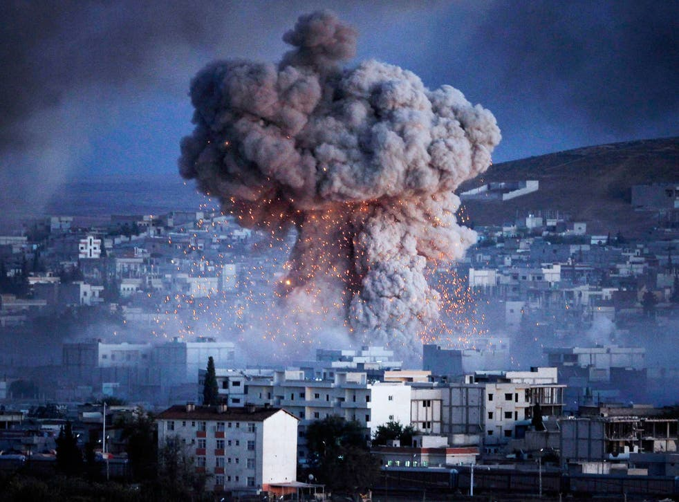 An explosion from a suicide car bomb attack rocks the city of Kobani in Syria, the least peaceful country in the world