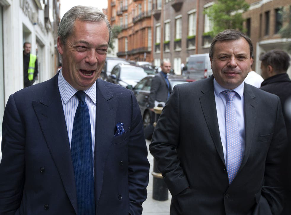 UK Independence Party (UKIP) leader Nigel Farage (L) and major donor Arron Banks leave the party's head office in central London on 15 May 2015.