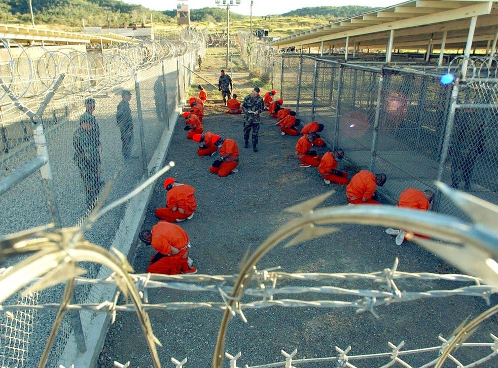 Military Police guard Taliban and al-Qaeda detainees at Guantanamo Bay prison