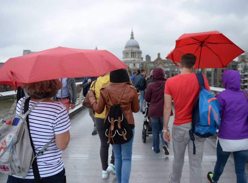 Tourists in London sheltering from the capital's weather