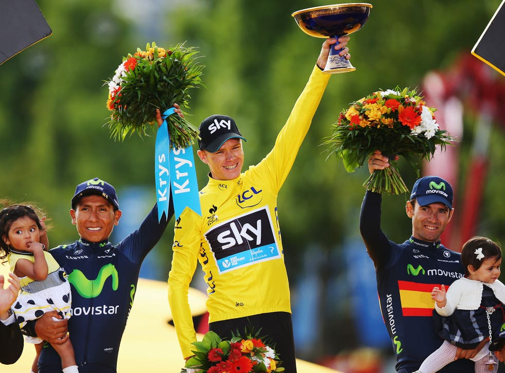 Tour de France winner Chris Froome, centre, celebrates alongside second placed Nairo Quintana, left, of Colombia and third placed Alejandro Valverde, right, of Spain