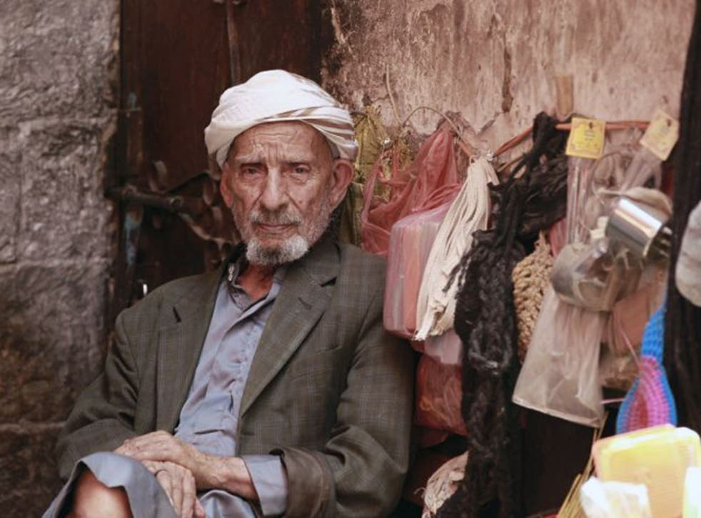 A Yemeni man sits at a stall at a market in the capital Sanaa's old city on July 27, 2015.