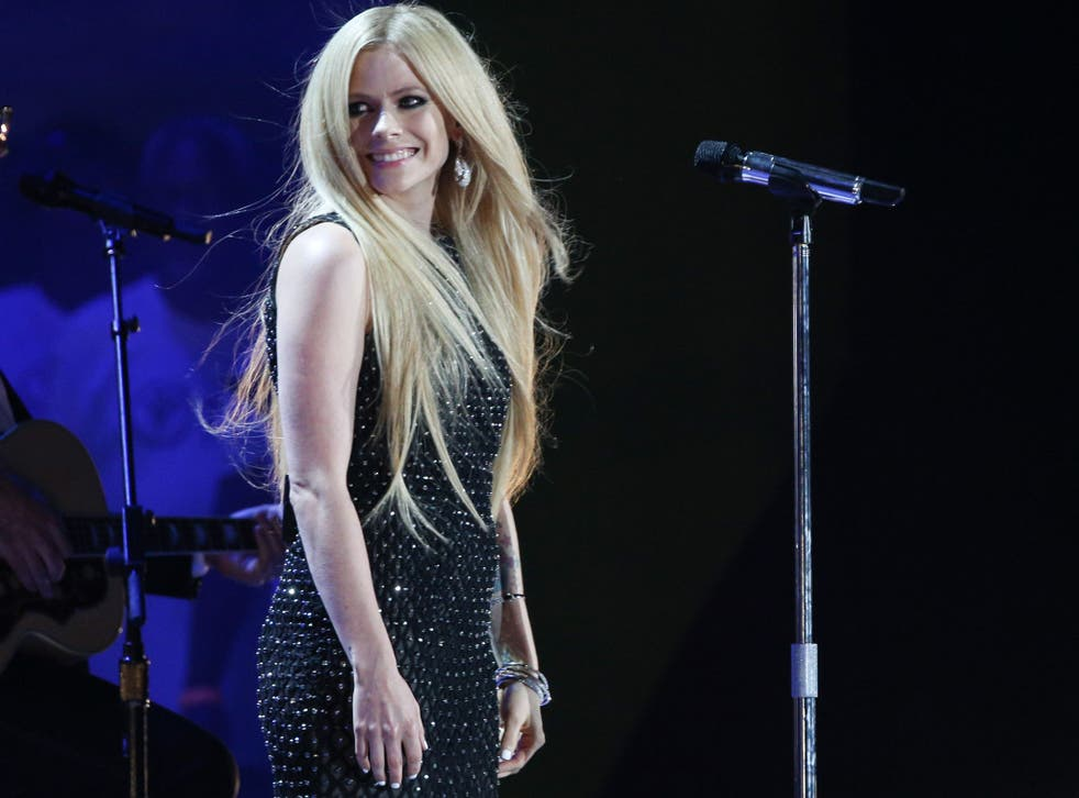 Avril Lavigne performs at the Opening Ceremony of the 2015 Special Olympics World Games at Los Angeles Memorial Coliseum