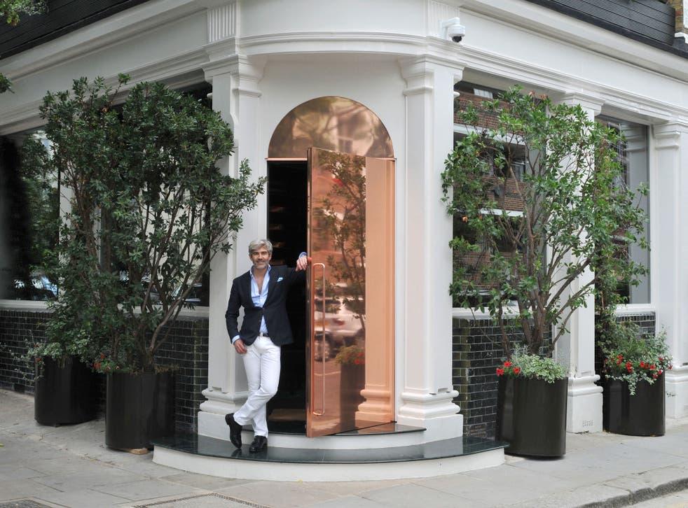 Juan Santa Cruz pictured outside his restaurant