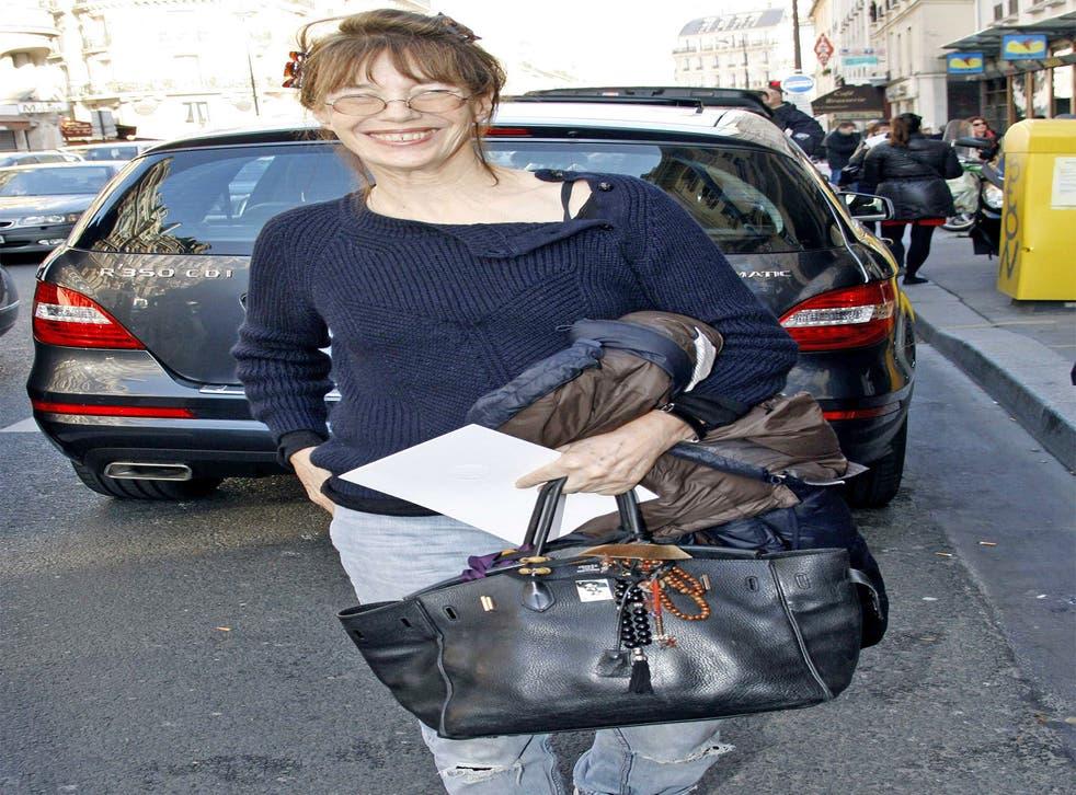 Bringing home the Birkin: Jane with her eponymous handbag