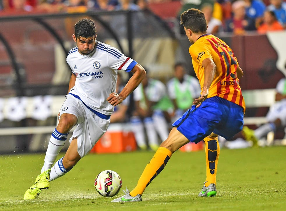 Diego Costa takes on Barcelona defender Marc Bartra during Chelsea's 2-2 draw in Washington on Tuesday. Chelsea won 4-2 on penalties
