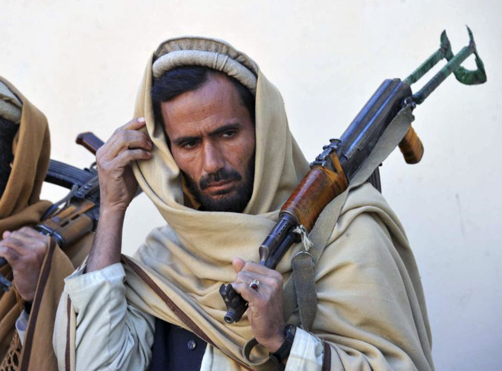 Former Taliban fighters remain well armed despite joining a peace and reconciliation process ceremony in Herat last year. Now they wait to find out if peace will be pursued