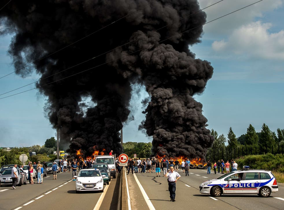 Striking employees of the My Ferry Link company block the access to the harbour after setting tyres on fire in Calais, following the failure of negotiations with French government concerning job cuts