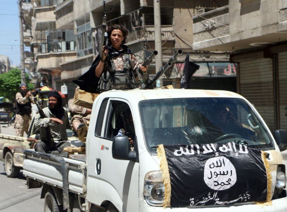 Jabhat al-Nusra fighters drive in armed vehicles through the northern Syrian city of Aleppo towards the frontline
