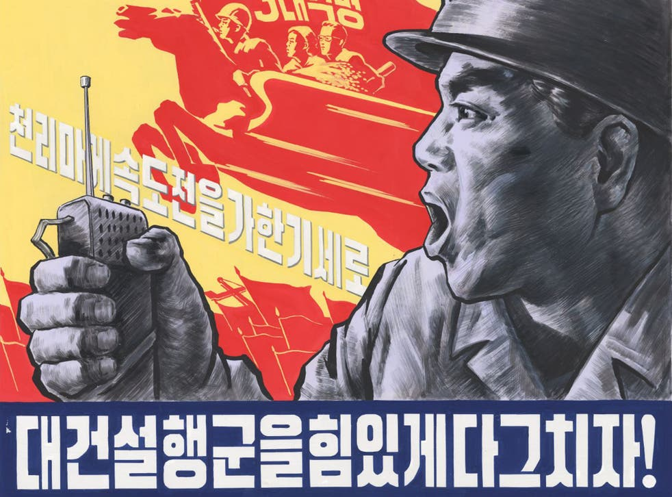 One of the Pyongyang posters, the slogan of which reads:  'Let the exploits of the northern railway conductors shine!'