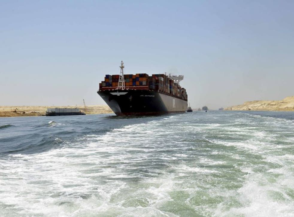A container ship in the new Suez Canal, due to be officially opened this week