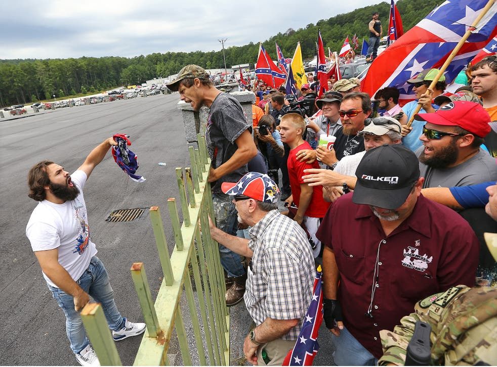 Man confronts Confederate flag rally