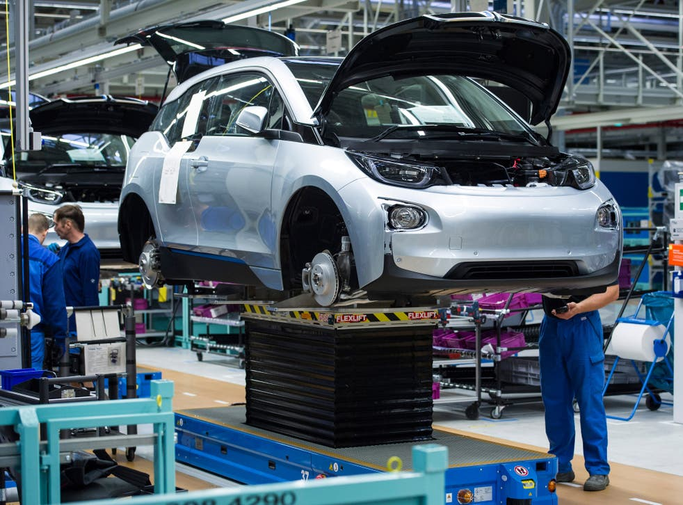 File photo: Workers at BMW factory assemble an i3 electric car