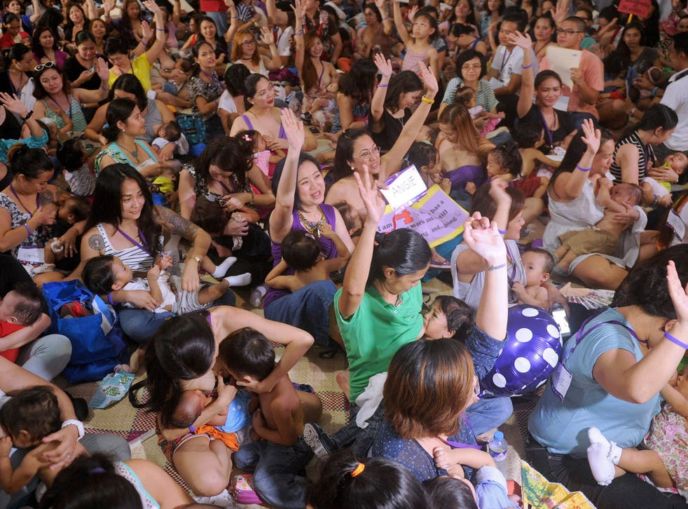 Hundreds of women participate in a mass breastfeeding event in Manila