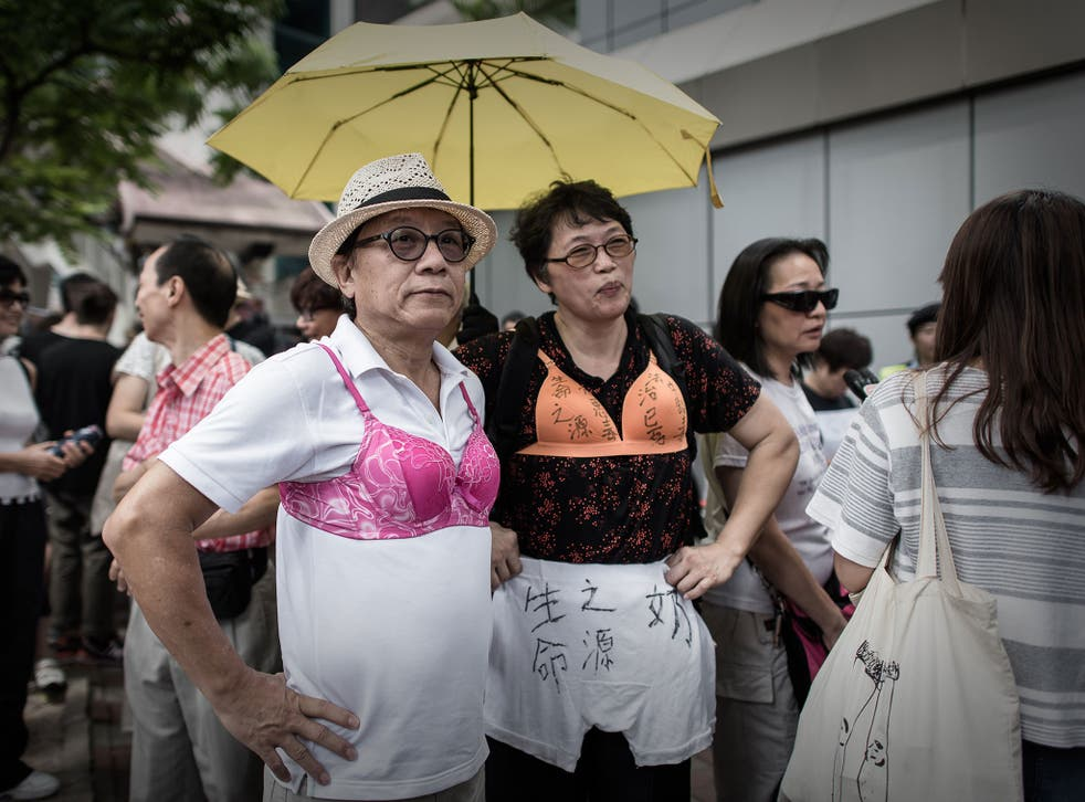 Men and women in Hong Kong have worn bras to protest the judge's decision