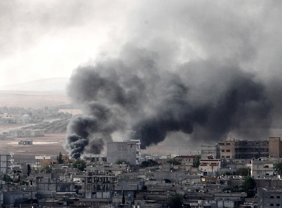 Smoke rises following an airstrike by a US-led coalition aircraft in Syria