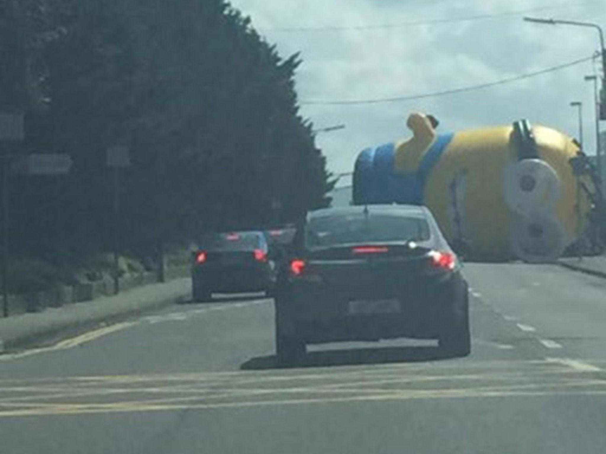 c02fa10ee8 Giant Minion terrorises drivers in Ireland as 40ft inflatable blocks  traffic on Dublin road