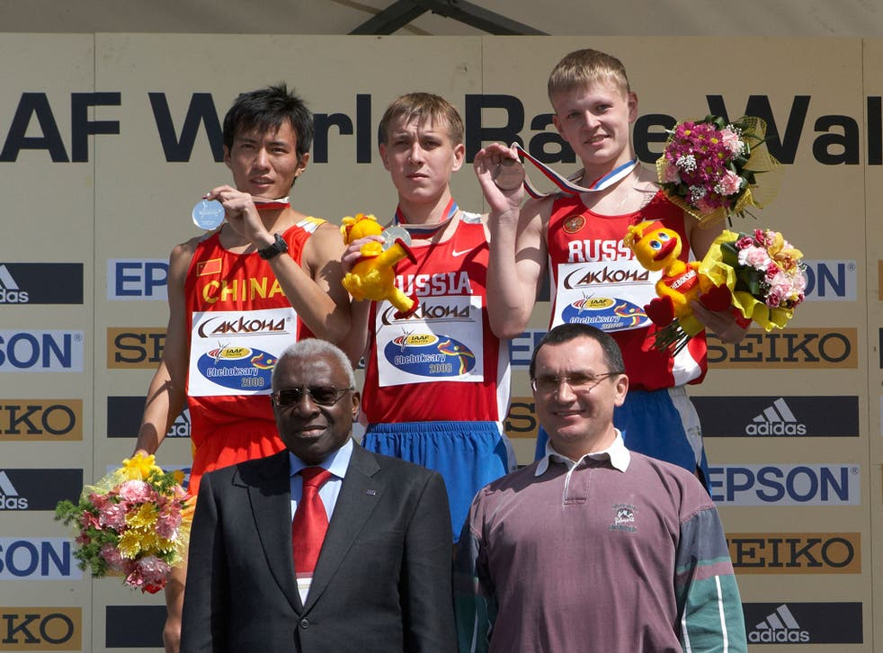 The IAAF president, Lamine Diack, front left, after presenting medals to junior athletes at the World Race Walking Cup in Russia in 2008