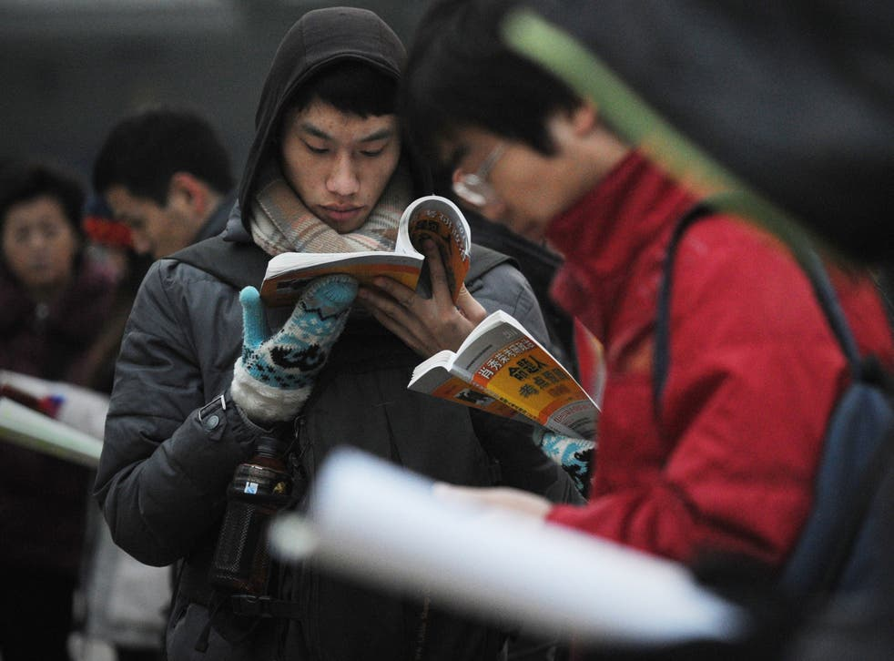 Students do last-minute revision before a university exam in Beijin