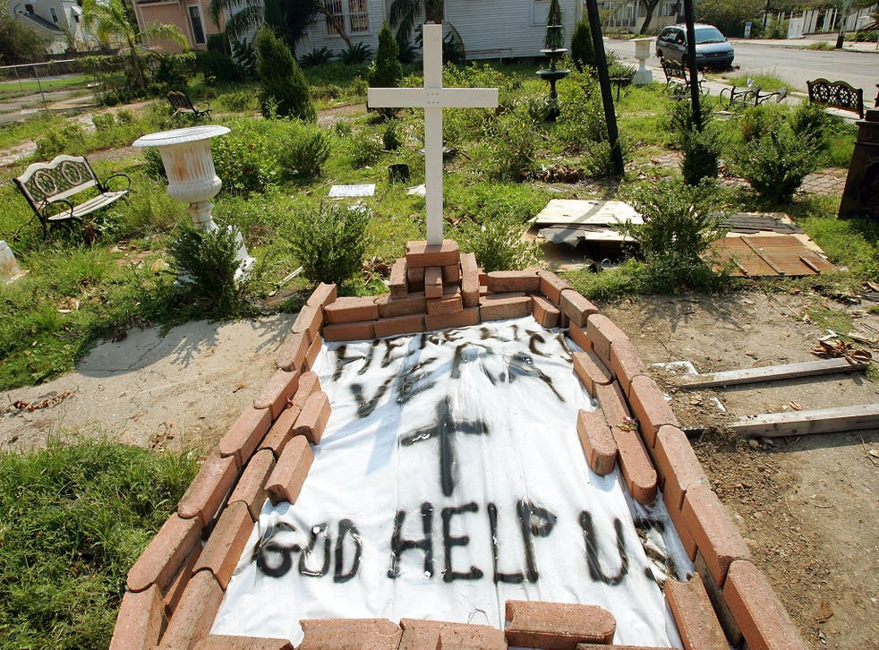 A makeshift grave is seen for a woman on a downtown street in New Orleans, Louisiana, 2005
