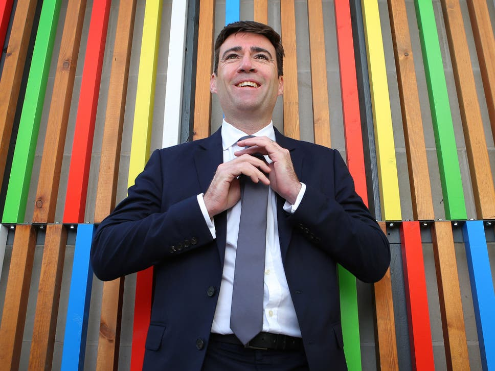 Andy burnham tells gq that he wears armani suits but he only buys andy burnham straightens his tie before a speech in leeds but is it armani or ccuart Choice Image