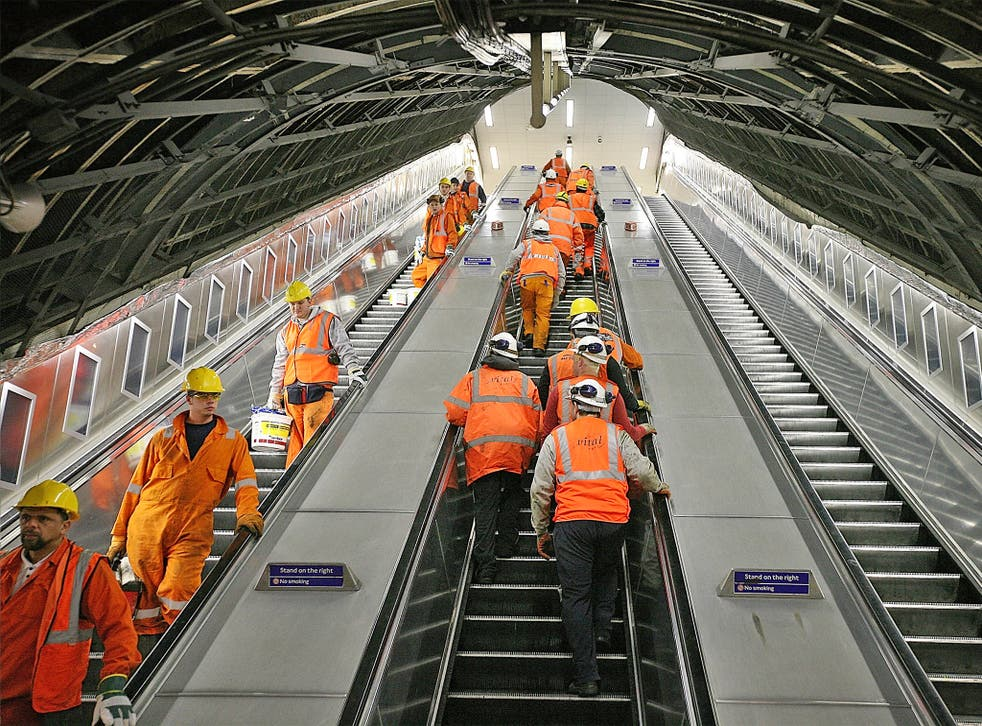 Maintenance workers arrive for their night shift at Victoria Underground station in London