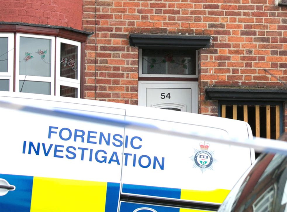 A forenic investigations van outside an even-numbered house in Leicester