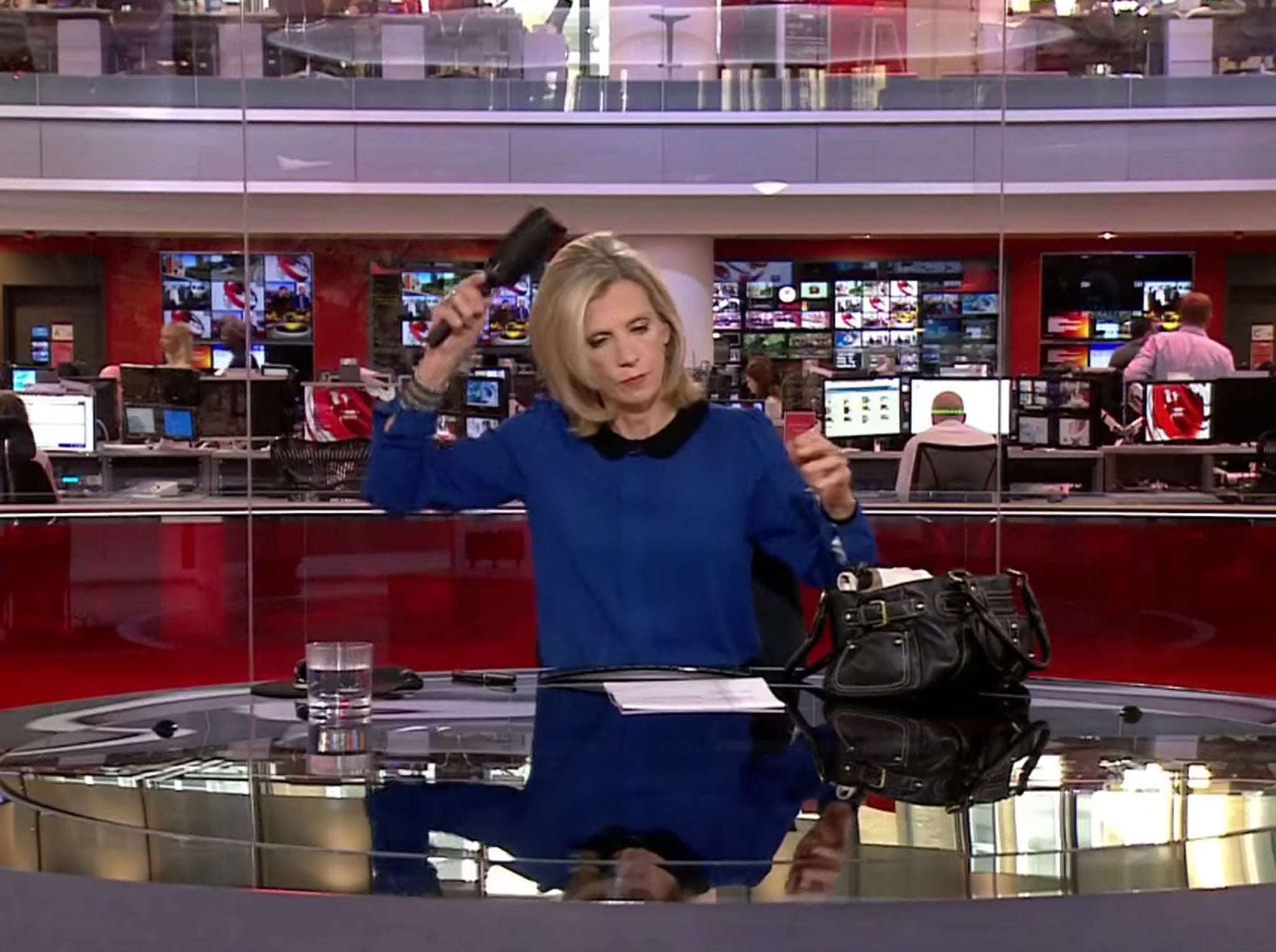 BBC presenter Carol Walker caught brushing hair on live TV - but handles it like a pro