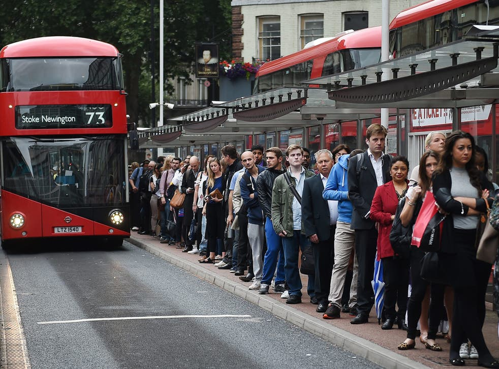 Commuters queue for buses during a tube strike at Victoria Station