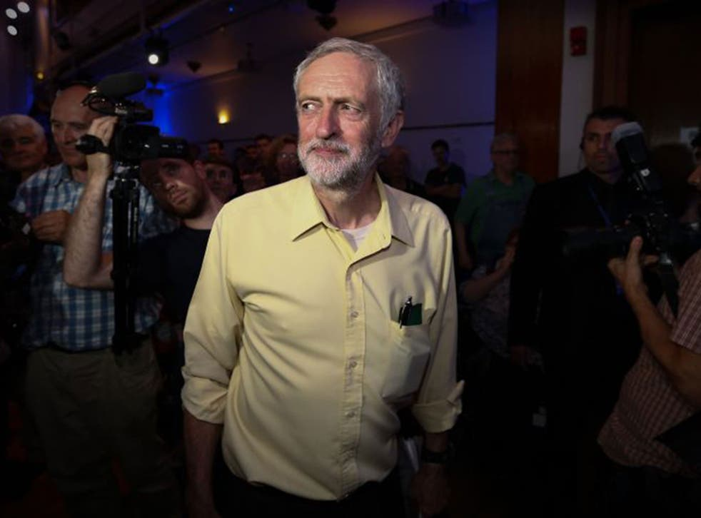 Jeremy Corbyn is greeted by supporters as he arrives at a Labour party leadership rally