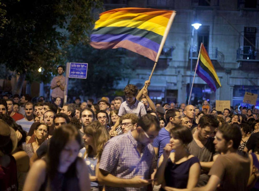 Israelis and members of the gay community attend an anti-homophobia rally following an attack on the Gay Pride Parade in July