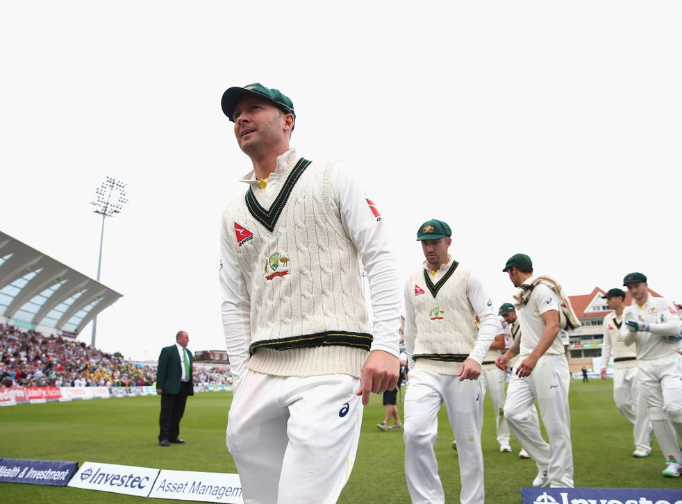 Michael Clarke of Australia walks from the ground after England declared
