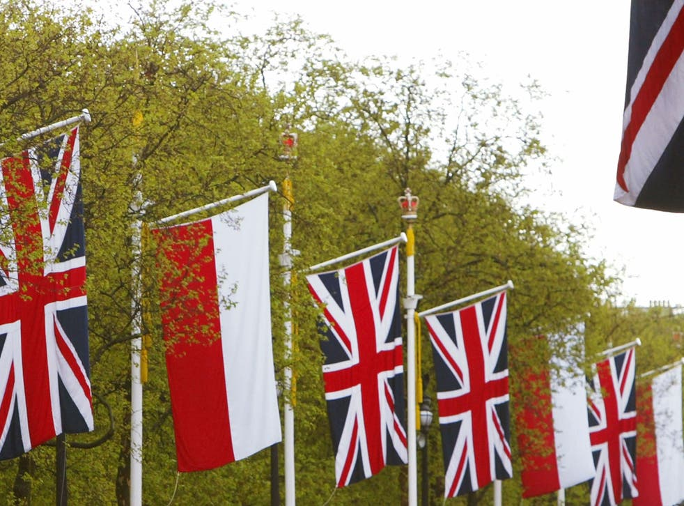 The flags of Poland and Great Britain adorn flag poles along The Mall in London