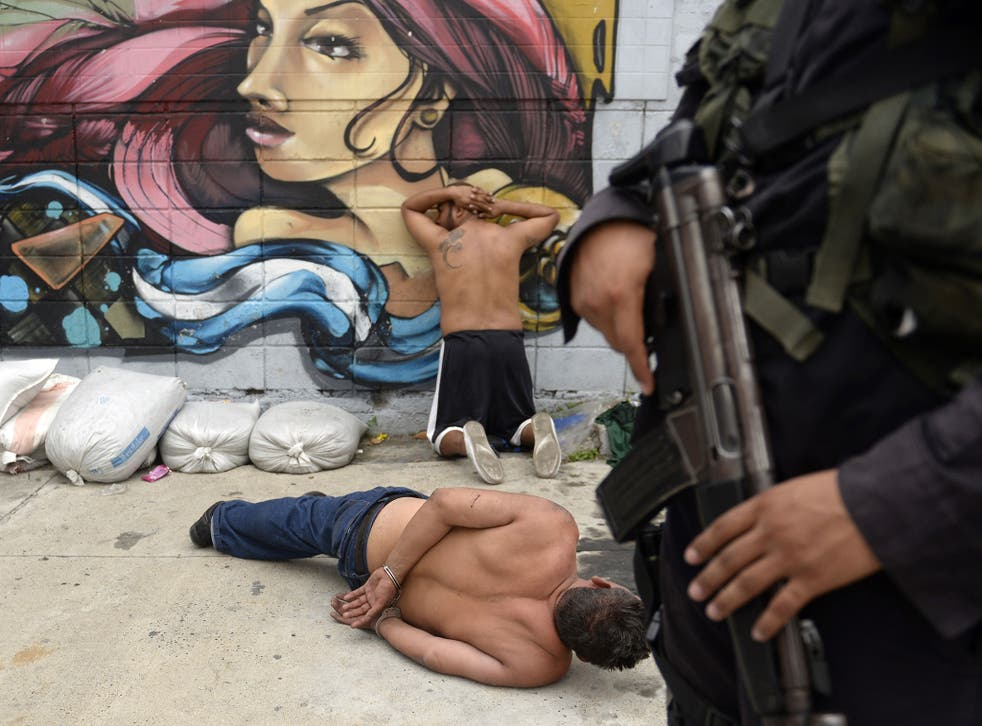 Members of the Barrio 18 gang are rounded up in San Salvador in May. An estimated 10,000 gang members are in the country's jails
