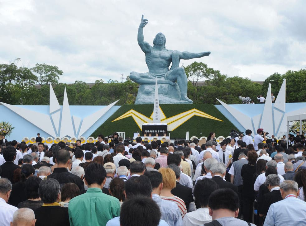 Thousands take place in a silent prayer service at the Nagasaki Peace Park on the bombing's anniversary in 2014