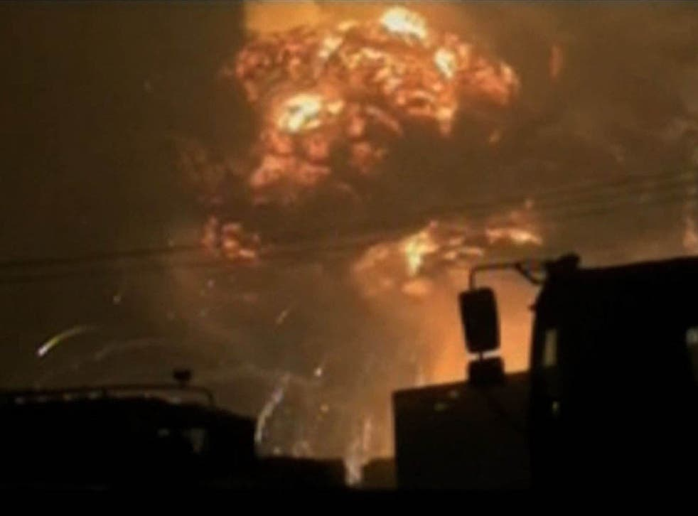 A screen grab from taken from state broadcaster China Central Television (CCTV) footage on August 12, 2015 shows a huge explosion in the northern Chinese port city of Tianjin.