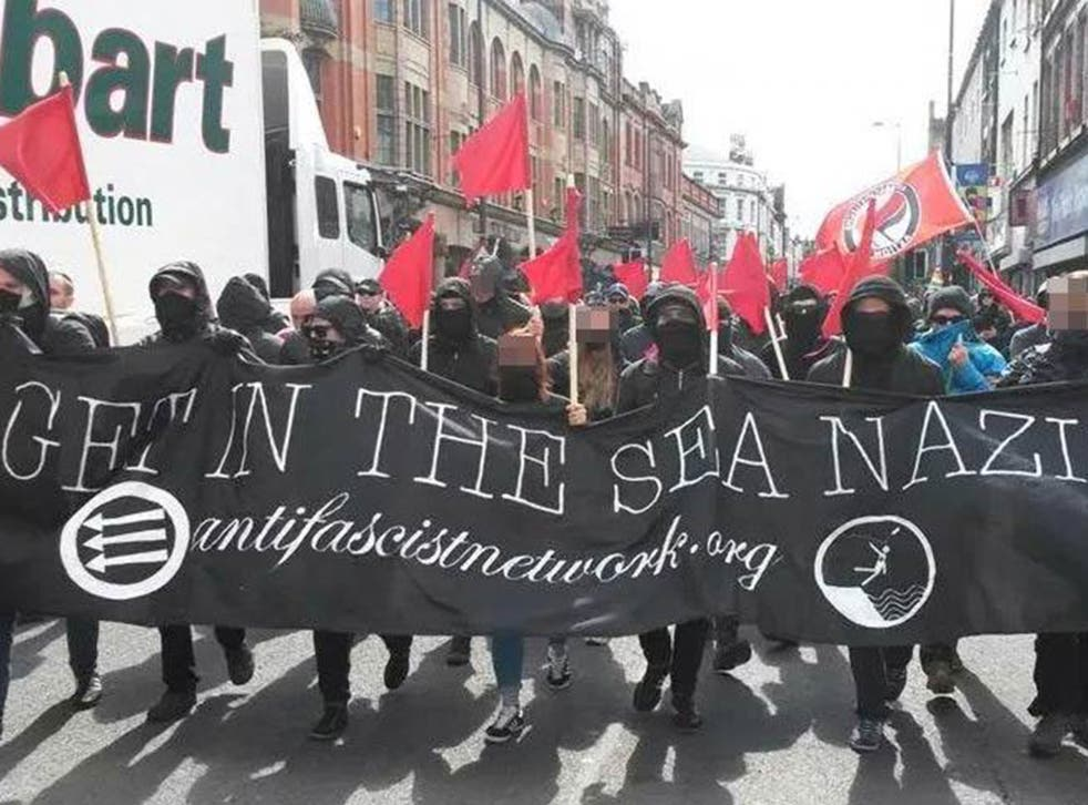 Anti-Fascism protesters carry a banner through Liverpool which reads 'Get in the sea, Nazis'