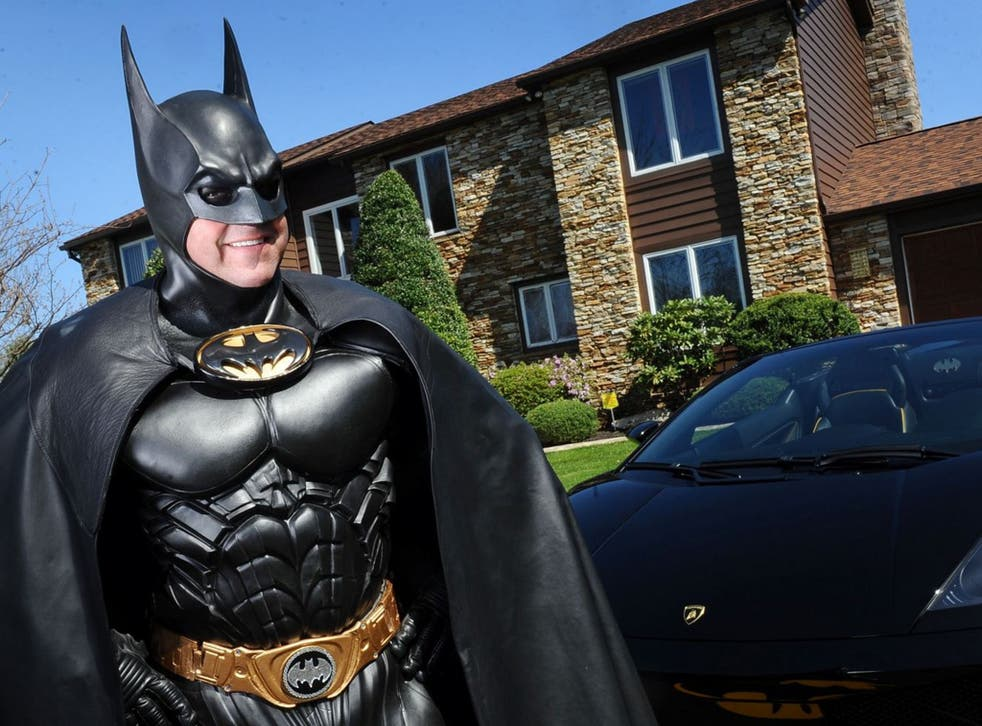 Lenny B. Robinson dressed up as Batman to hand out gifts at hospitals