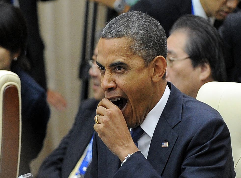 President Barack Obama trying to hide a yawn - we've seen you Prez.