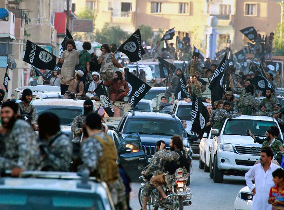 Fighters from Isis parading in Raqqa, northern Syria, where the 'Islamic State' has its capital.