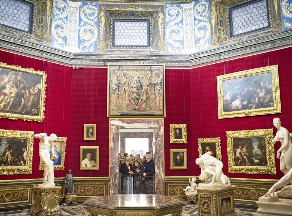 Angela Merkel, Antonio Natali and Matteo Renzi tour the Uffizi Gallery