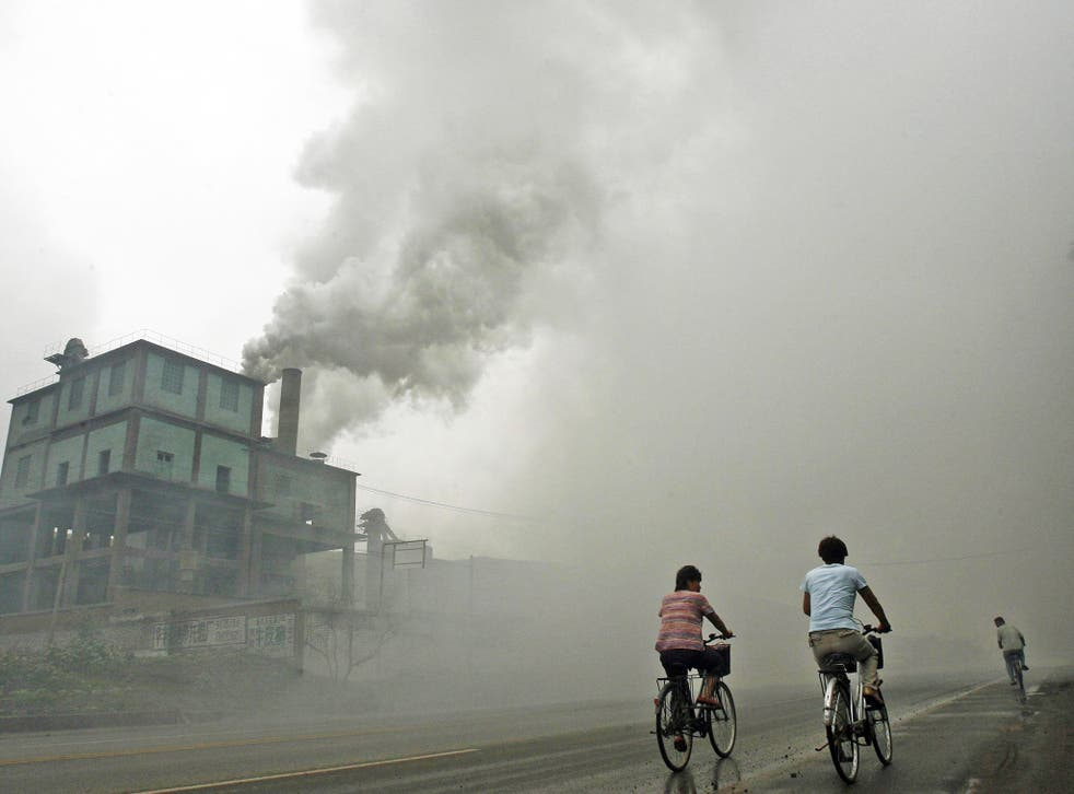 Stock image showing thick pollution from a factory in Yutian, 100km east of Beijing, China
