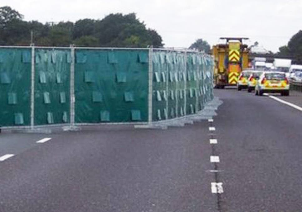 Screens used to stop motorists peering into crash sites deployed