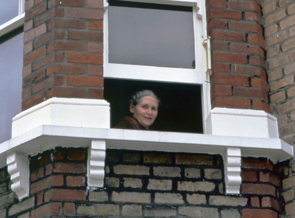 Doris Lessing looking out the window of her London flat (AFP)