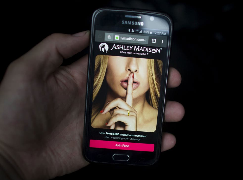 The Ashley Madison website displayed on a smartphone (Reuters)