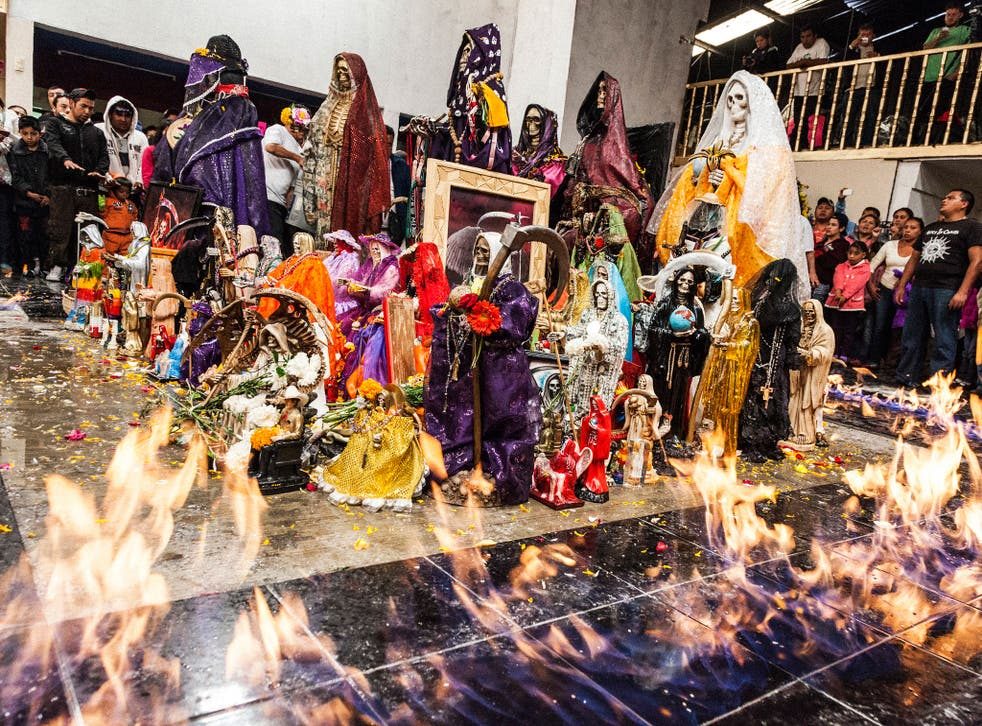 'Baptism of Fire, Pachuca, Mexico' - Santa Muerte statuettes are consecrated and baptised with tequila then set alight