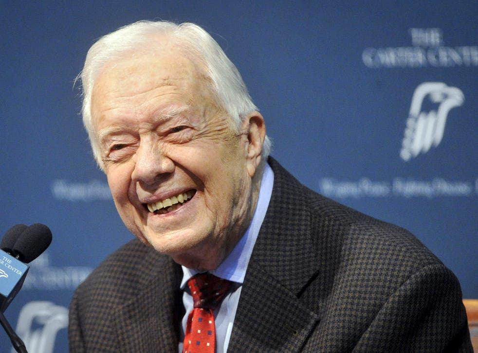 Former U.S. President Jimmy Carter takes questions from the media during a news conference about his recent cancer diagnosis and treatment plans