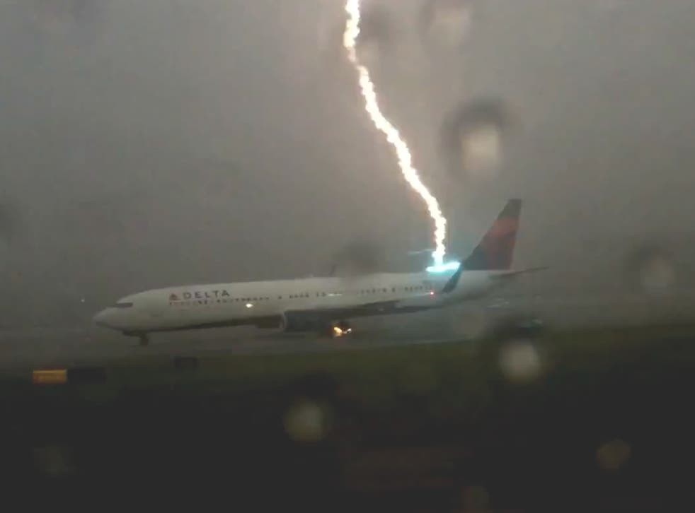 The exact moment a lightning strikes an airplane on the tarmac in Georgia