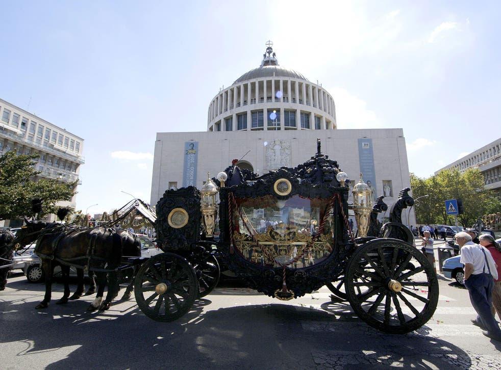The horse-drawn hearse outside the Don Bosco parish church