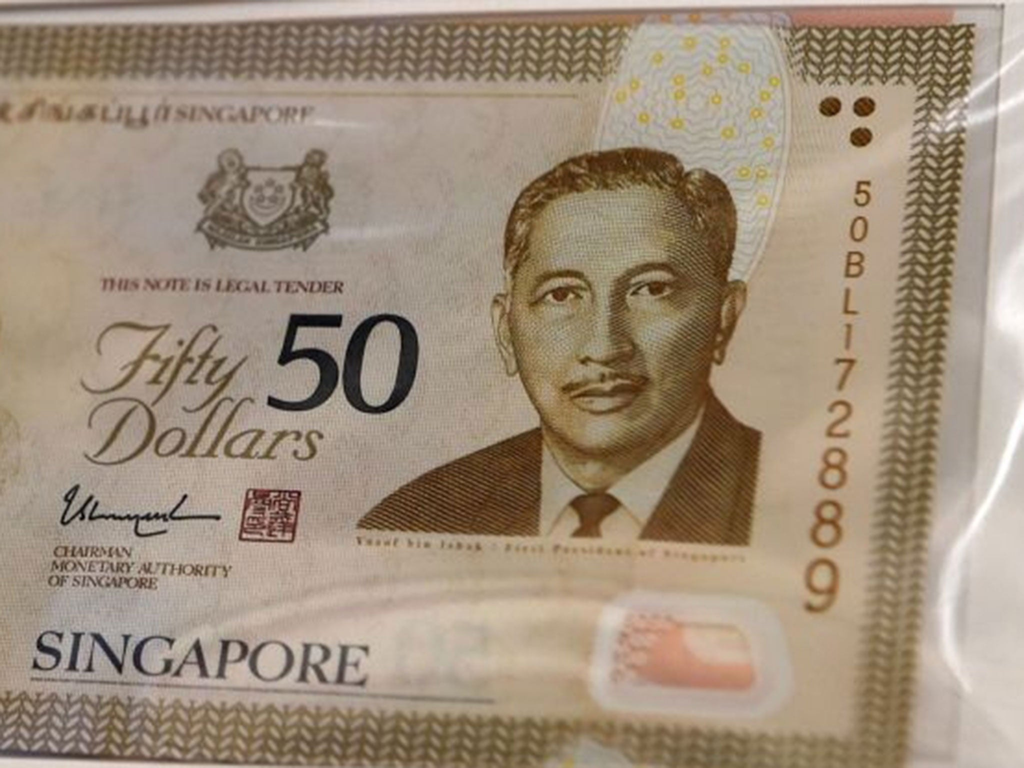 What is the name of singapore currency / T mobile phone top up